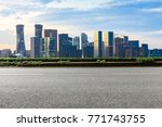 asphalt highway and modern city ... | Shutterstock . vector #771743755