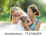 kids play with farm animals.... | Shutterstock . vector #771746359