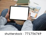 male hand holds tablet pad in... | Shutterstock . vector #771756769