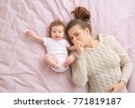 Young Mother And Cute Baby On...