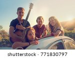 group of happy people in a car... | Shutterstock . vector #771830797