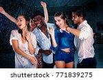 group of friends dancing under... | Shutterstock . vector #771839275