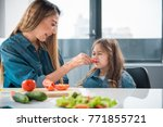 smiling woman is giving piece... | Shutterstock . vector #771855721