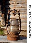 antique kerosene lamp on the... | Shutterstock . vector #77187643