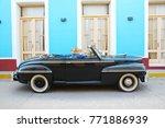 An Oldtimer Car On The Streets...