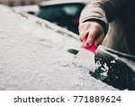 A Woman Is Cleaning An Icy...