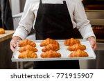 baker presenting freshly baked... | Shutterstock . vector #771915907