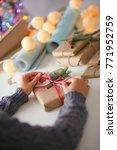 hands of woman decorating... | Shutterstock . vector #771952759