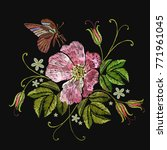 embroidery rose and butterfly....   Shutterstock .eps vector #771961045
