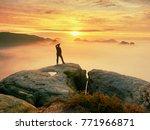 photographer silhouette above a ... | Shutterstock . vector #771966871