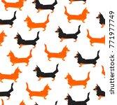 polygonal dogs seamless pattern....   Shutterstock .eps vector #771977749