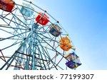 ferris wheel against the blue... | Shutterstock . vector #77199307