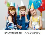 three friendly children in... | Shutterstock . vector #771998497