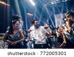 shot of a young man dancing in... | Shutterstock . vector #772005301