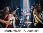 Group Of Friends Dancing In Th...