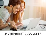 young couple using laptop on... | Shutterstock . vector #772016557