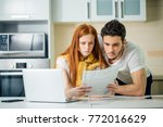 couple managing finances ... | Shutterstock . vector #772016629