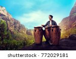 drummer with wooden drums plays ... | Shutterstock . vector #772029181