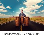 drummer with wooden drums plays ... | Shutterstock . vector #772029184