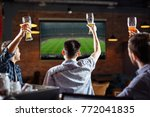 happy soccer fans. three... | Shutterstock . vector #772041835