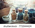 bottles and jars of healing... | Shutterstock . vector #772044424