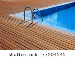 blue swimming pool with teak... | Shutterstock . vector #77204545