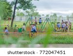 kids playing on playground ... | Shutterstock . vector #772047451