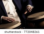 hands of a musician playing on ... | Shutterstock . vector #772048261