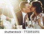 sun shines over stunning... | Shutterstock . vector #772051051