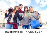 students holding tour guide... | Shutterstock . vector #772076287