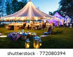Colorful wedding tents at night....