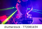 dj with headphones playing... | Shutterstock . vector #772081654