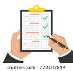 hand with black pen and... | Shutterstock .eps vector #772107814