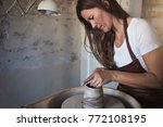 artisan using a sculpting tool... | Shutterstock . vector #772108195