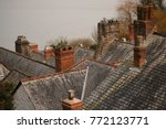 multiple chimneys on different... | Shutterstock . vector #772123771