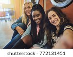 group of smiling young female... | Shutterstock . vector #772131451