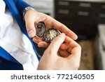 hands of the groom with a... | Shutterstock . vector #772140505