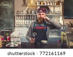 confident bearded barista in... | Shutterstock . vector #772161169