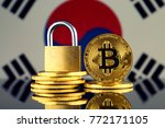Small photo of Physical version of Bitcoin, golden padlock and South Korea Flag. Prohibition of cryptocurrencies, regulations, restrictions or security, protection, privacy.