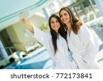 Two Attractive Ladies Taking A...