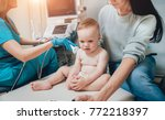 doctor and little boy patient.... | Shutterstock . vector #772218397