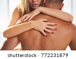 female hands on male back.... | Shutterstock . vector #772231879