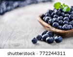 Blueberry On White Wooden Tabl...
