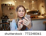 concentrated middle aged woman... | Shutterstock . vector #772248361