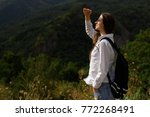 beautiful girl with backpack... | Shutterstock . vector #772268491