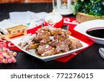 christmas table and a plate of... | Shutterstock . vector #772276015