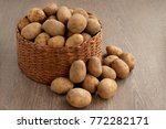 a lot of potatoes in a wicker... | Shutterstock . vector #772282171