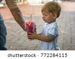 toddler with snow cone | Shutterstock . vector #772284115