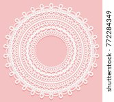 round doily on a pink... | Shutterstock . vector #772284349