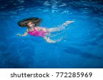pool safety   young girl... | Shutterstock . vector #772285969